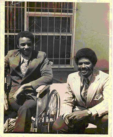 Image: Brad Lomax and his brother Glenn. Two young african american men in suits. One is in a wheelchair