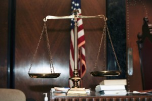 Justice scales and flag in a courtroom