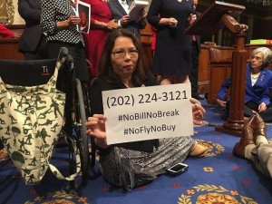 Tammy Duckworth sitting on the floor of the House